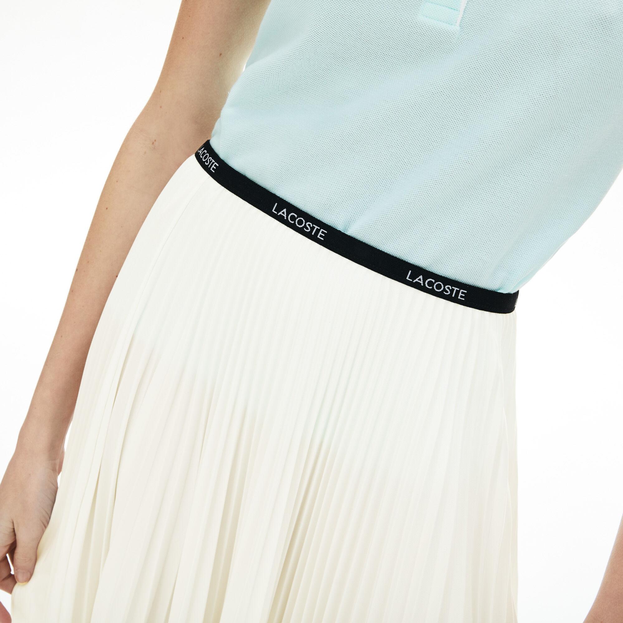 تنورة بطيات مطاطية مزينة بالعلامة التجارية للنساء
