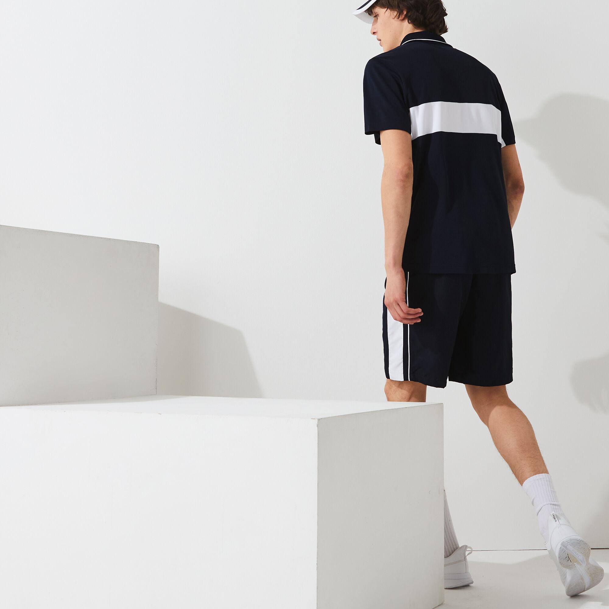 قميص بولو مقاوم مسامي للرجال مع كتل لونية مجموعة Lacoste SPORT